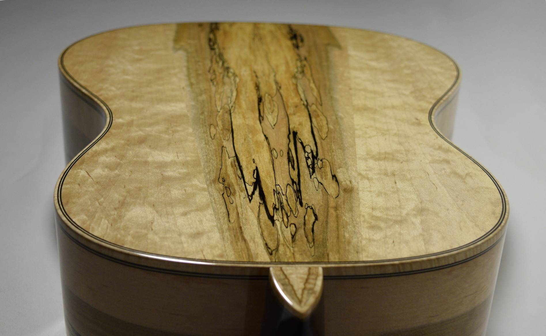 The heal cap has a book-matched, ambrosia maple inlay