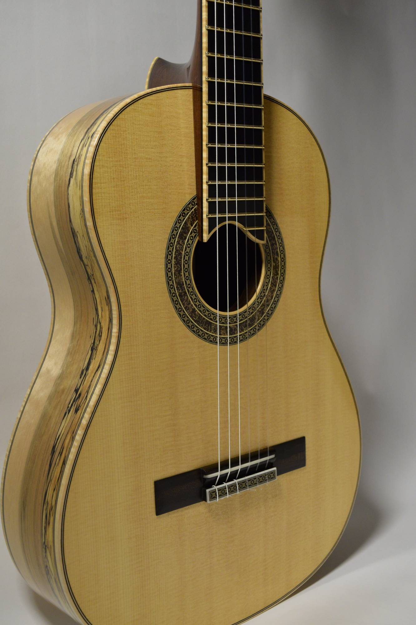 It became quickly clear that the guitar wouldn't be complete without a maple fretboard binding