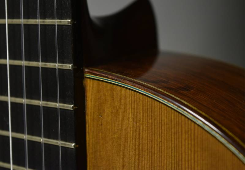 The fretboard has been resurfaced for playability yet the original frets have been kept intact.