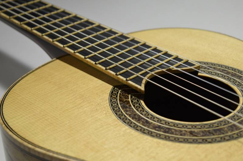 There is a slight elevation in the neck angle in addition to a sloping down of the top that given better access to the upper frets